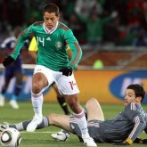 Javier Hernandez of Mexico rounds Hugo Lloris goalkeeper of France to score the opening goal against France